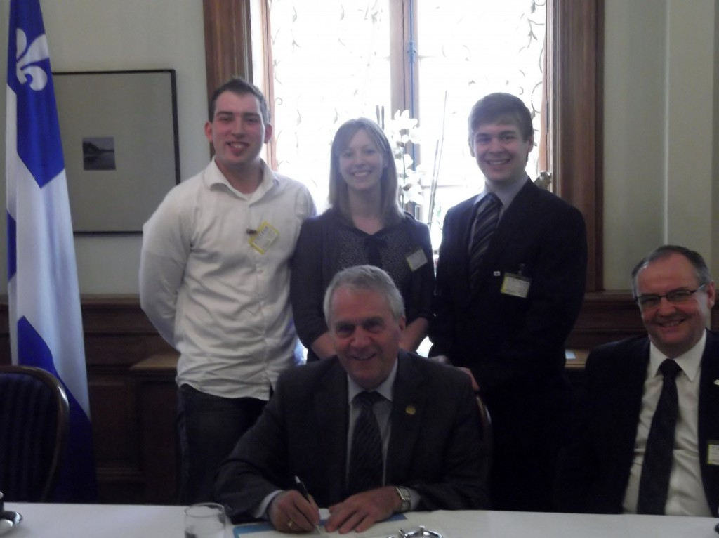 Quebec 4-H President Mathieu Rouleau and AJRQ President Marie-Pier Vincent along with a representative from the FRAQ were pleased to have Minister of Agriculture Francois Gendron sign a declaration to acknowledge the importance of the rural youth movement.